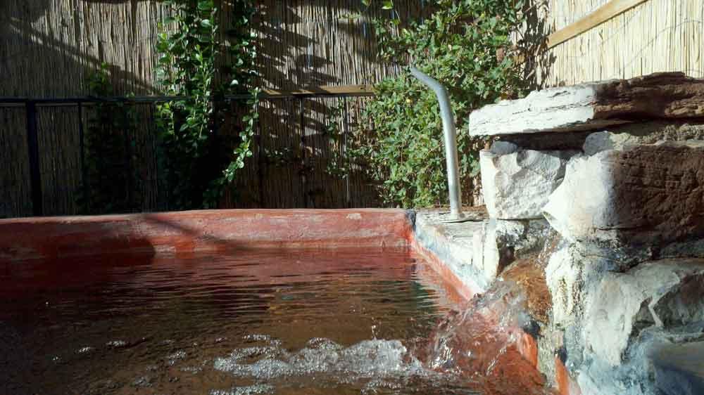 Outdoor bath at Riverbend Hot Springs