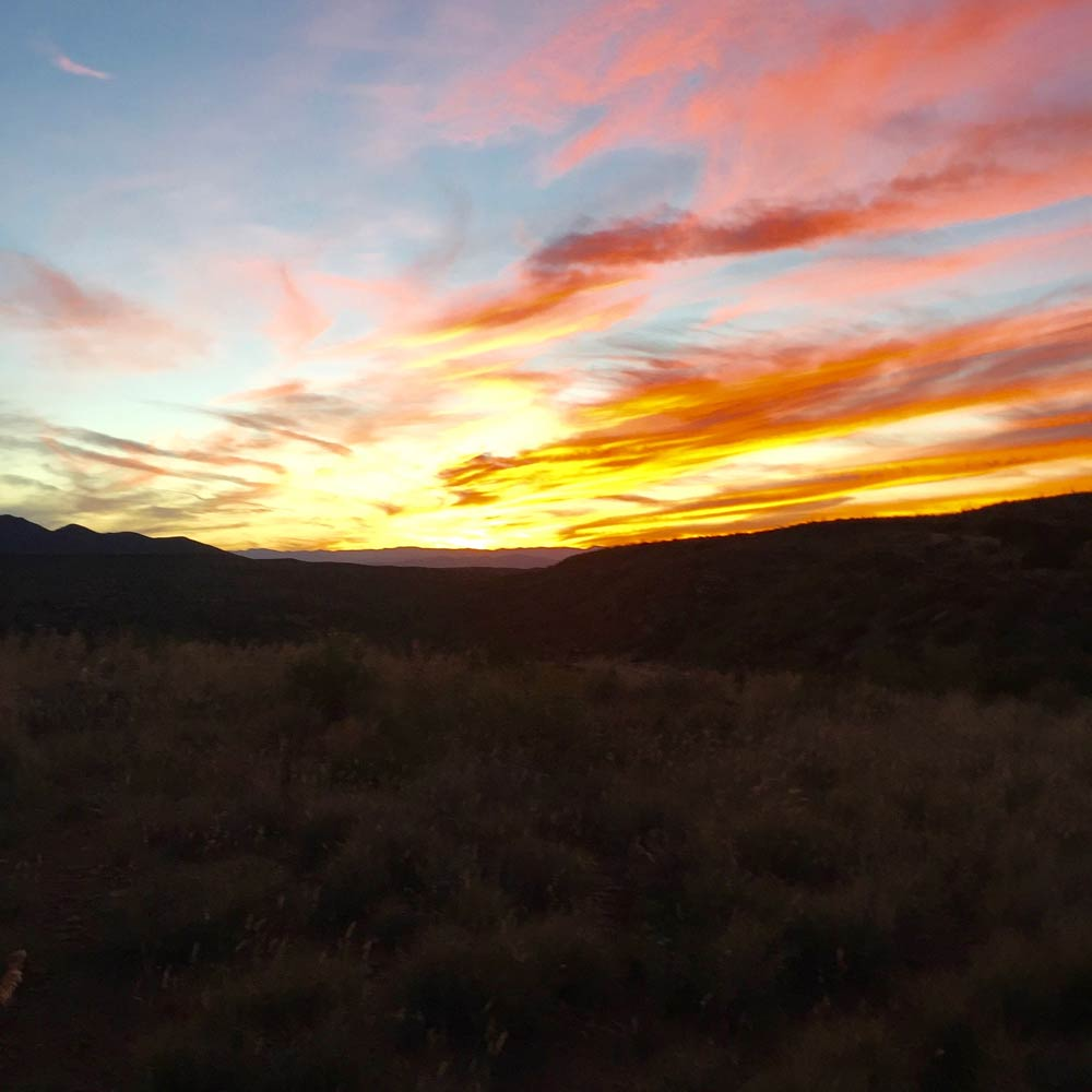 a fiery sunset on the Geronimo Trail National Scenic Byway